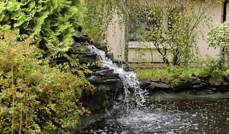 Berms, hardscaping and water features are great ways to use landscaping features to reduce noise.